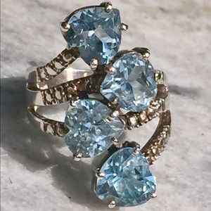 Stunning 4 heart Natural Light Blue Topaz Ring